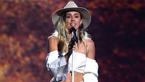Seeking Theme Song Artist Jamaican Artist Flourgon Sues Miley Cyrus Song We Can T Stop