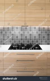 white kitchen cupboards black bench front on view kitchen black gas stock photo edit now