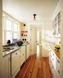 apartment galley kitchen ideas bright galley kitchen with hardwood floors for the home