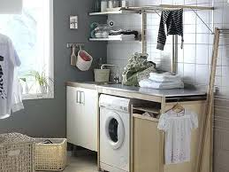 bathroom cabinet with built in laundry her bathroom laundry basket vivaskor com
