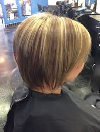 layred hairstyles eith high low lifhts blonde dark red and brown streaks highlights modified bob