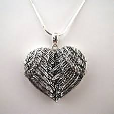 silver wing necklace images Big angel wing locket necklace sterling silver JPG