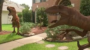 dinosaurs on s front lawn yard turns heads in planned
