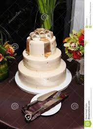 wedding cake with gold bow topper modern classy stock photo
