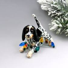 bluetick coonhound gifts bluetick coonhound ornament with toy raccoon porcelain sculpture