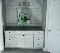 staggering bathroom cabinet knobs and pulls tab pull cabinet