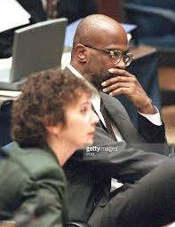 prosecutor christopher darden r listens with mar pictures