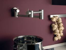 charming pot filler faucet with purple paint walls and stainless