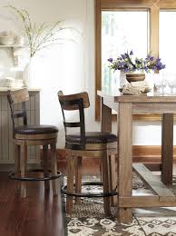5 piece counter table set with upholstered swivel stools with wood