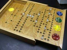 hand made wooden aggravation game board this board has a story