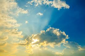 beautiful heavenly landscape with the sun in the clouds stock photo