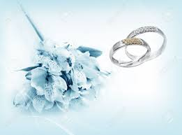 blue wedding rings flower beautiful flowers and wedding rings on blue background