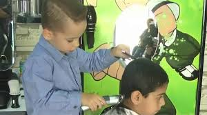 see the 4 year old boy who cuts hair in his father u0027s barber shop
