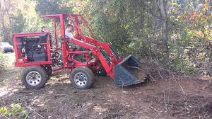 articulating tractor front end loader clearing brush homemade