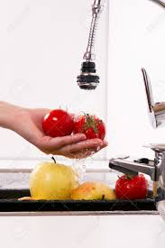 Red Kitchen Faucet by Kitchen Faucet Wash Your Fruits And Vegetables Stock Photo