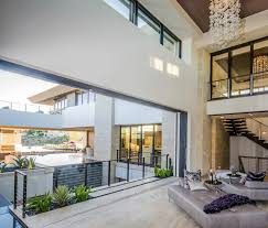 home with balcony and railing u2013 modern house