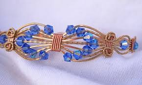 beads wire bracelet images Blue ab bicone czech beads in bronze and copper wire wrapped jpg