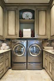 Storage Cabinets For Laundry Room by Laundry Room Storage Cabinets With Distressed Cabinets And Silver