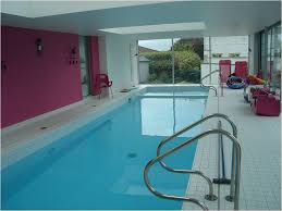modern indoor swimming pool designs with extra large sliding glass