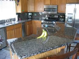 granite countertop short kitchen cabinets fireplace backsplash