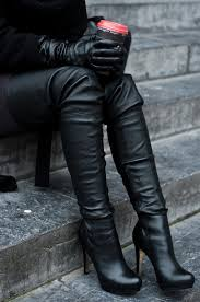 womens boots in these thigh high boots paired with the leather gloves are a