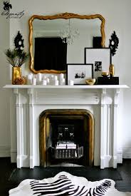 Fancy Fireplace by Gold Mirror Fireplace Mantel White Candles Framed Photographs