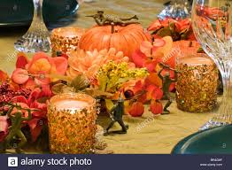 military themed autumn centerpiece fills table with silk flowers