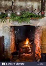 medieval christmas decorations over fireplace during tudor event