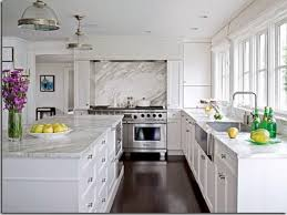white wooden kitchen cabinet and kitchen island with white granite