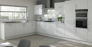 Slab Door Kitchen Cabinets by Find Yourself Easily Dancing Around This Open White Kitchen Get A