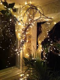 grapevine wrapped with white lights and tool front porch sitting