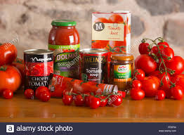 tomatoes and tomato products on a country kitchen table including