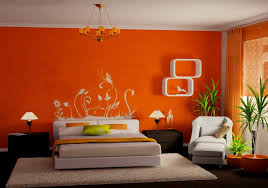 modern orange bedroom design ideas with cream bed and orange