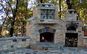 atlanta stone fireplaces outdoor fire pits grills cherokee stone added a wrought iron insert in the fireplace stone bench seating surrounds the patio