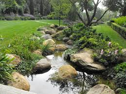 use black river rock landscaping as decorative accent for your