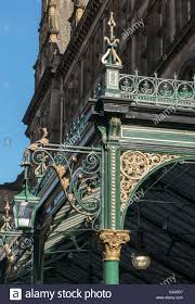 detail of ornamental cast iron canopy outside central stock photo