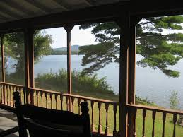 six bedroom lakehouse with 500 sq ft wrap around screen porch and