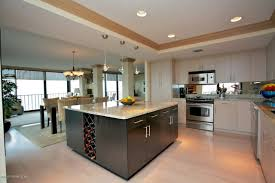 high end kitchen cabinet with white and black design plus wine