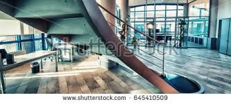 modern office interior circular stairs business stock photo