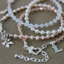 stacking bracelets pearl stacking bracelets with silver charms by bish bosh becca