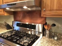 this rustic brown copper backsplash was made with our 10 mil