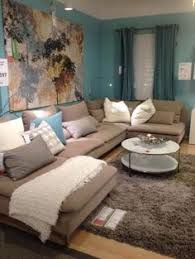 grey couch with cool pillows could also add some accent color