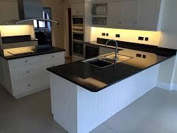 black worktop white cupboards kitchen choosing a countertop to match white units granite line