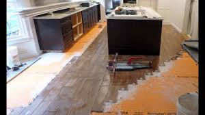 how do you attach island cabinets to the floor how to install floor tile around a kitchen island with wood look plank tile
