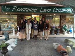 ceo class visits roadrunner lawn ornaments