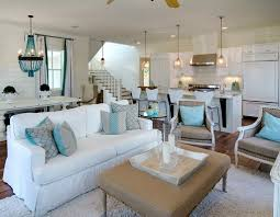 tropical themed living room white with leather ottoman coffee table and glass pendant