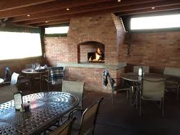 covered outdoor patio with fireplace picture of salsa brava