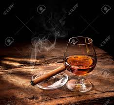 whiskey photography glass of whiskey with smoking cigar and ice cubes on wooden table
