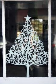 Classy Christmas Window Decorations by Snowflake Window Clings Christmas Tree How Much Is That Doggie