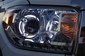 Porsche Cayenne Xenon Retrofit - panamera headlight projector shrouds from the retrofit source